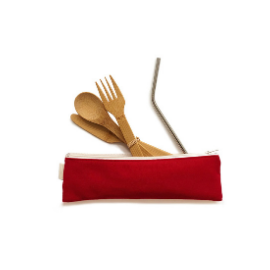 Red cotton zipper pouch with bamboo cutlery and stainless steel metal straw splayed out of the open part of the bag.