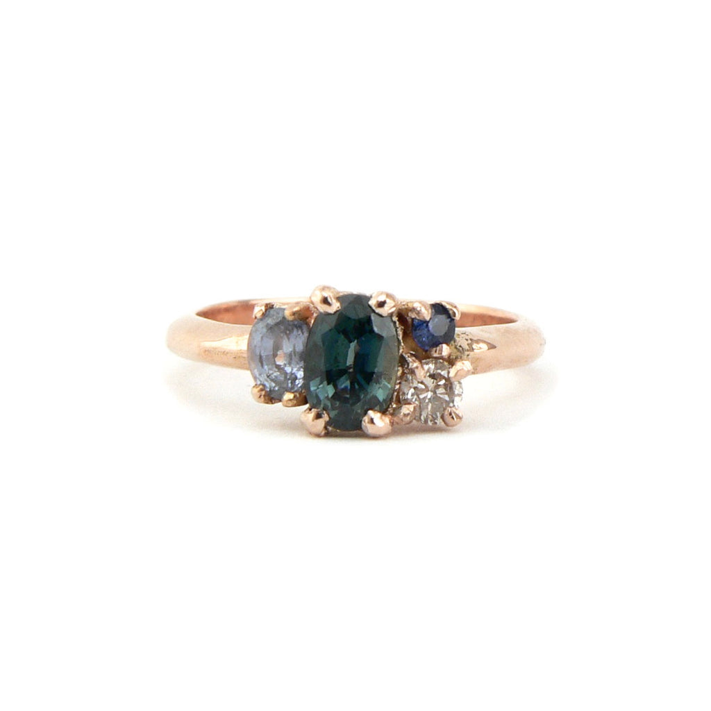 sapphire engagement cluster ring in rose gold