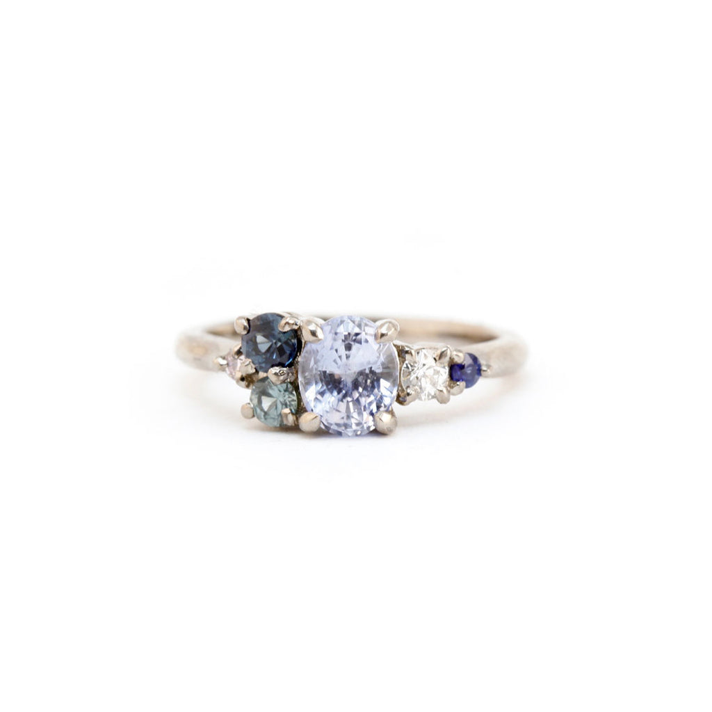 sapphire engagement cluster ring in white gold