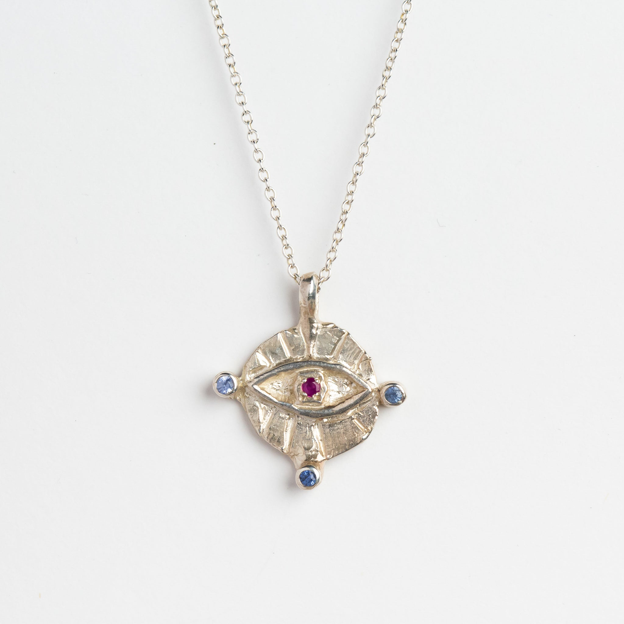 Pink blue and green ceylon sapphires, in silver eye pendant on silver chain, custom bespoke handmade jewellery