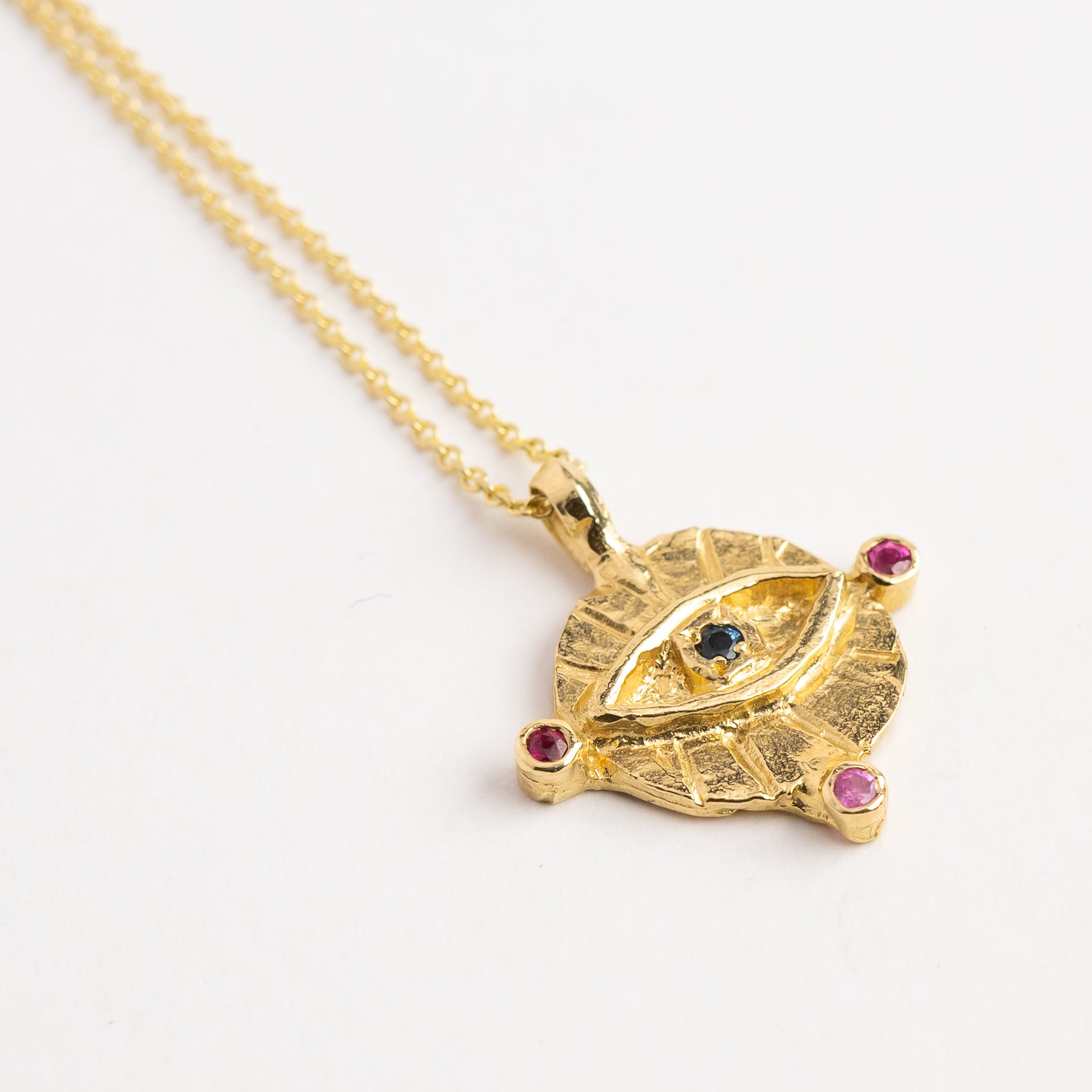 Pink blue and green ceylon sapphires, in gold eye pendant on 9ct gold chain, custom bespoke handmade jewellery