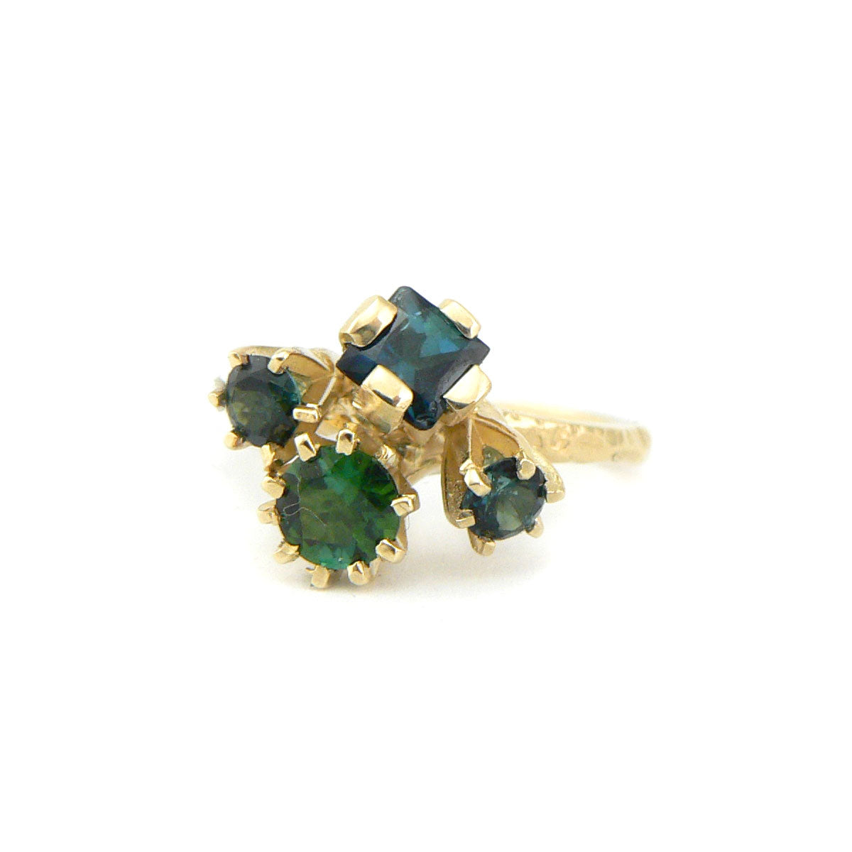 Green tourmaline cluster ring in yellow gold