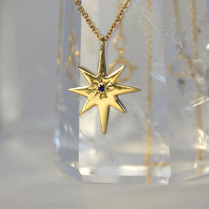 gold star pendant with sapphire
