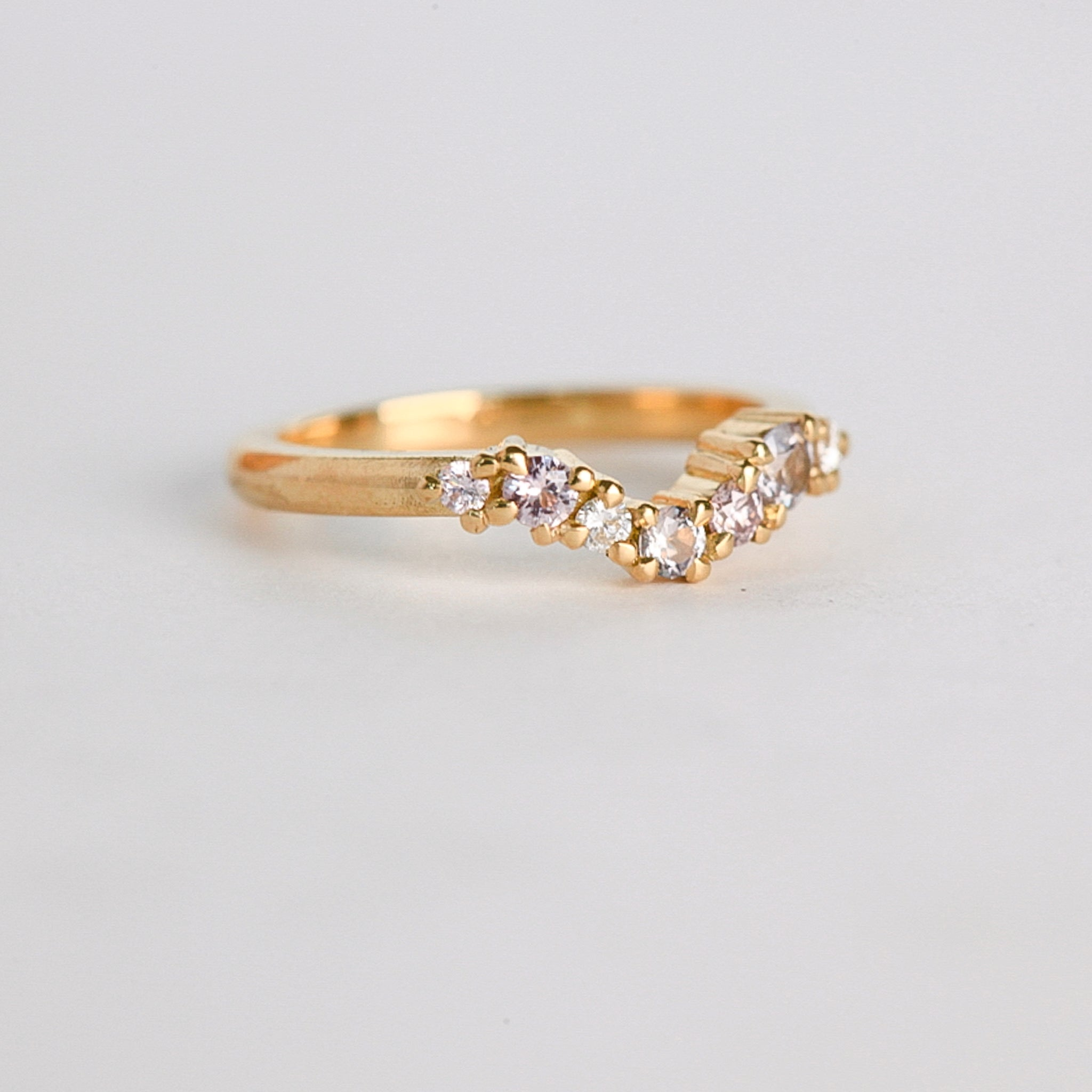 Made in Melbourne, 18ct yellow gold curved engagement ring with a row of diamonds.