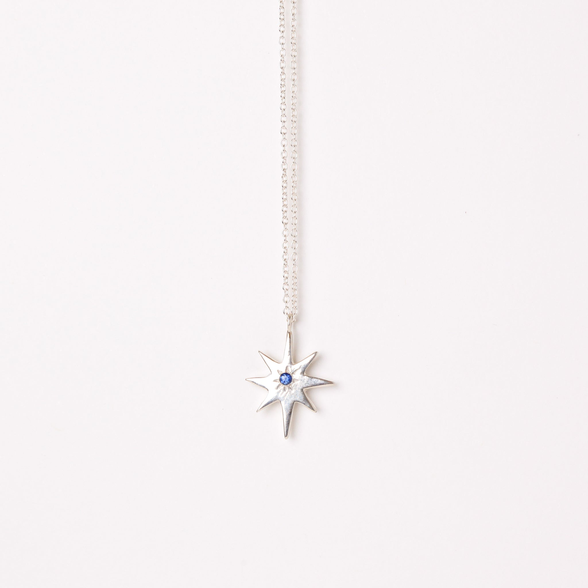 Sterling silver star pendant with ethically sourced Australian blue sapphire on a sterling silver chain. Custom Bespoke Handmade.