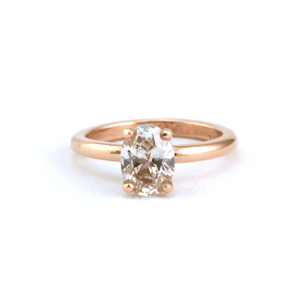Oval cut 1ct diamond engagement ring in 18ct rose gold.