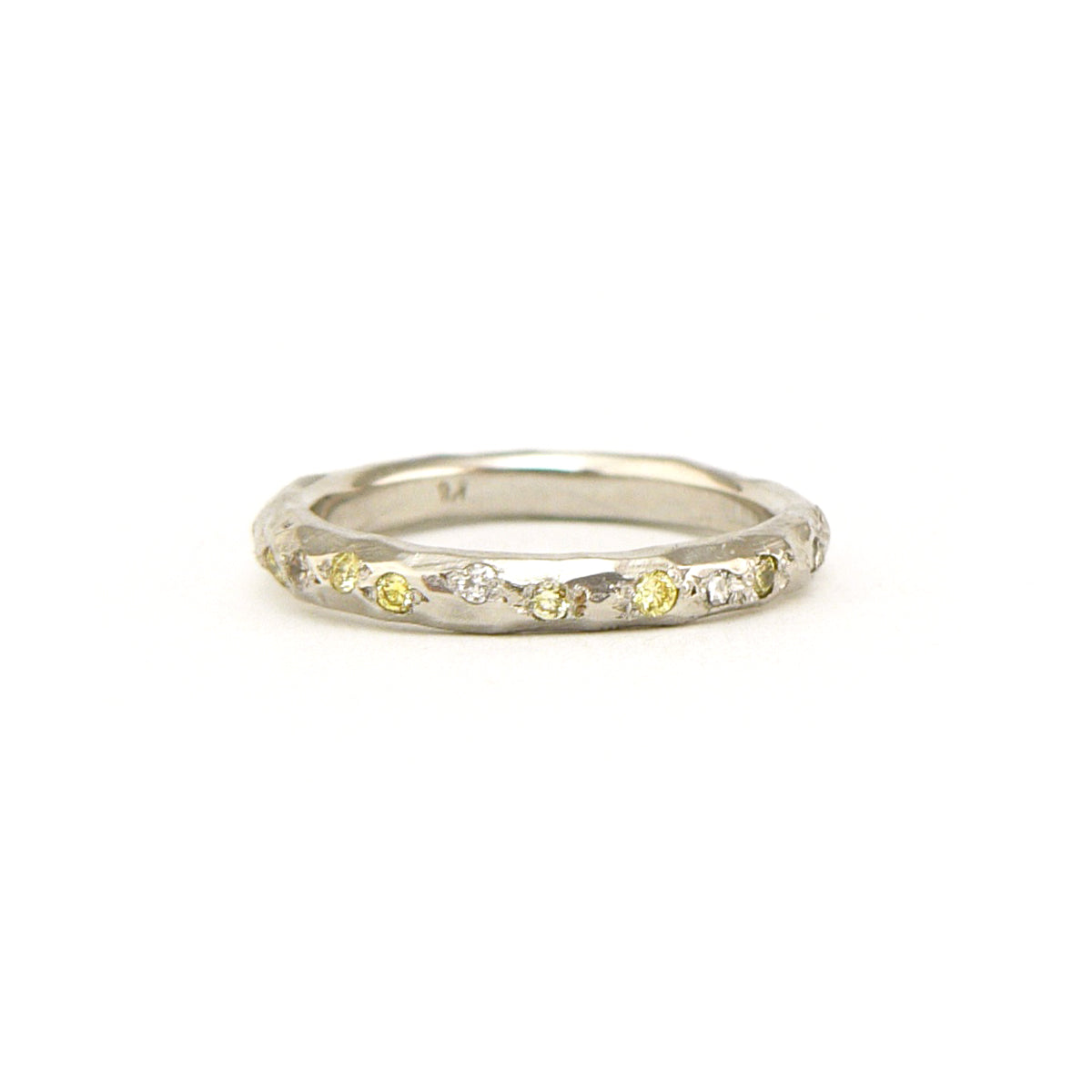 yellow and white diamond wedding band in platinum