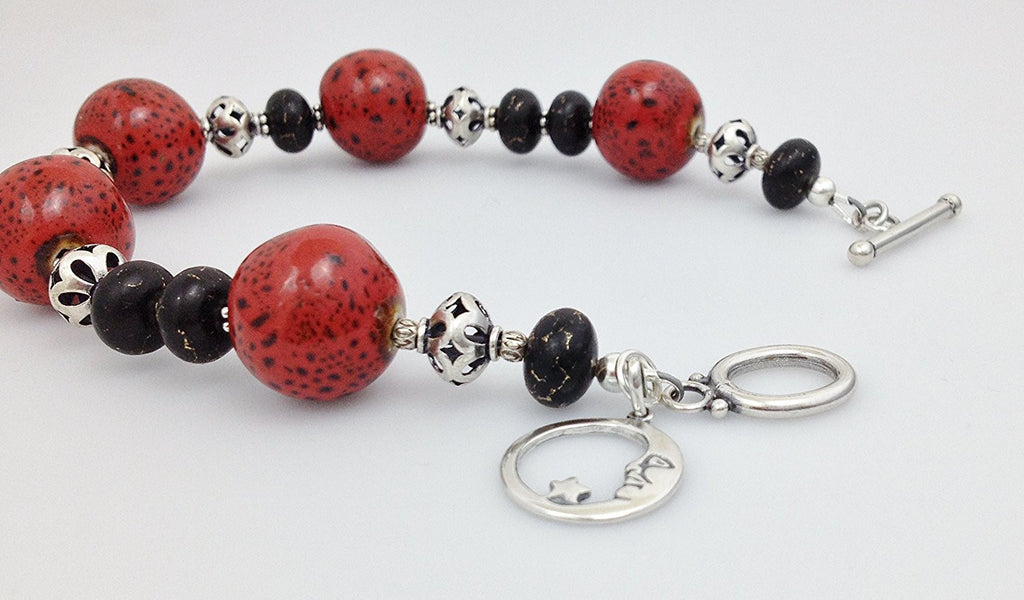 Sterling Silver, Red/ Black Raku Porcelain and Bronze Infused Black Turquoise Bracelet - Zuzi's