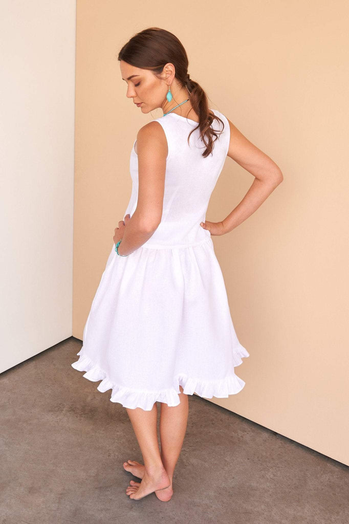 ladies wearing Italian white linen knee length skirt