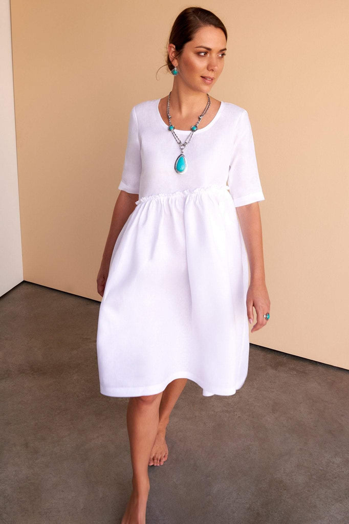 ladies white linen knee length dress with high waste line