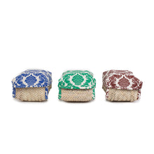 three palm weaved decorative boxes with a blue cover, green cover and red cover