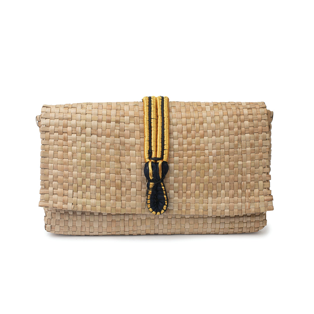 The front of a handmade clutch bag made with natural woven palm leaf,