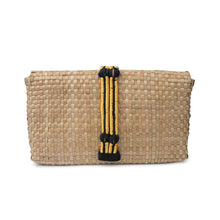 The back of a handmade clutch bag made with natural woven palm leaf,