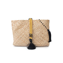 A gold hand made, natural, hand-woven 'Saaf' (palm fronds) clutch bag
