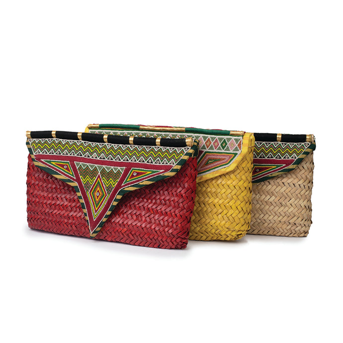 A group of all-natural, hand-woven palm leaf clutch bag