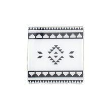 Plexiglass coaster with a printed Sadu pattern in black and white
