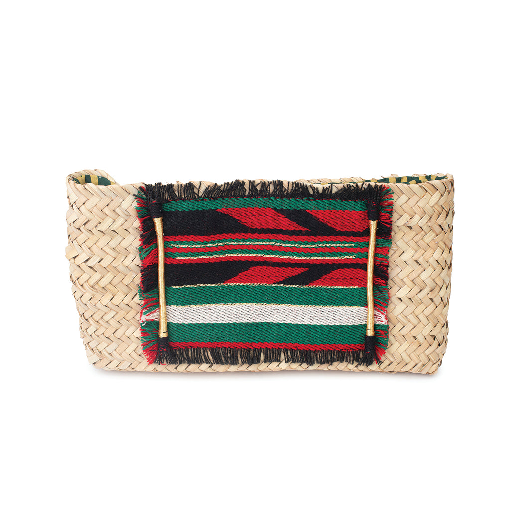 Front view of a natural hand-woven palm frond clutch with an original traditional Sadu piece