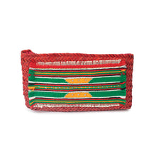 Front view of a naturally-dyed (red) hand-woven palm frond clutch with an original traditional hand-embroidered Sadu piece