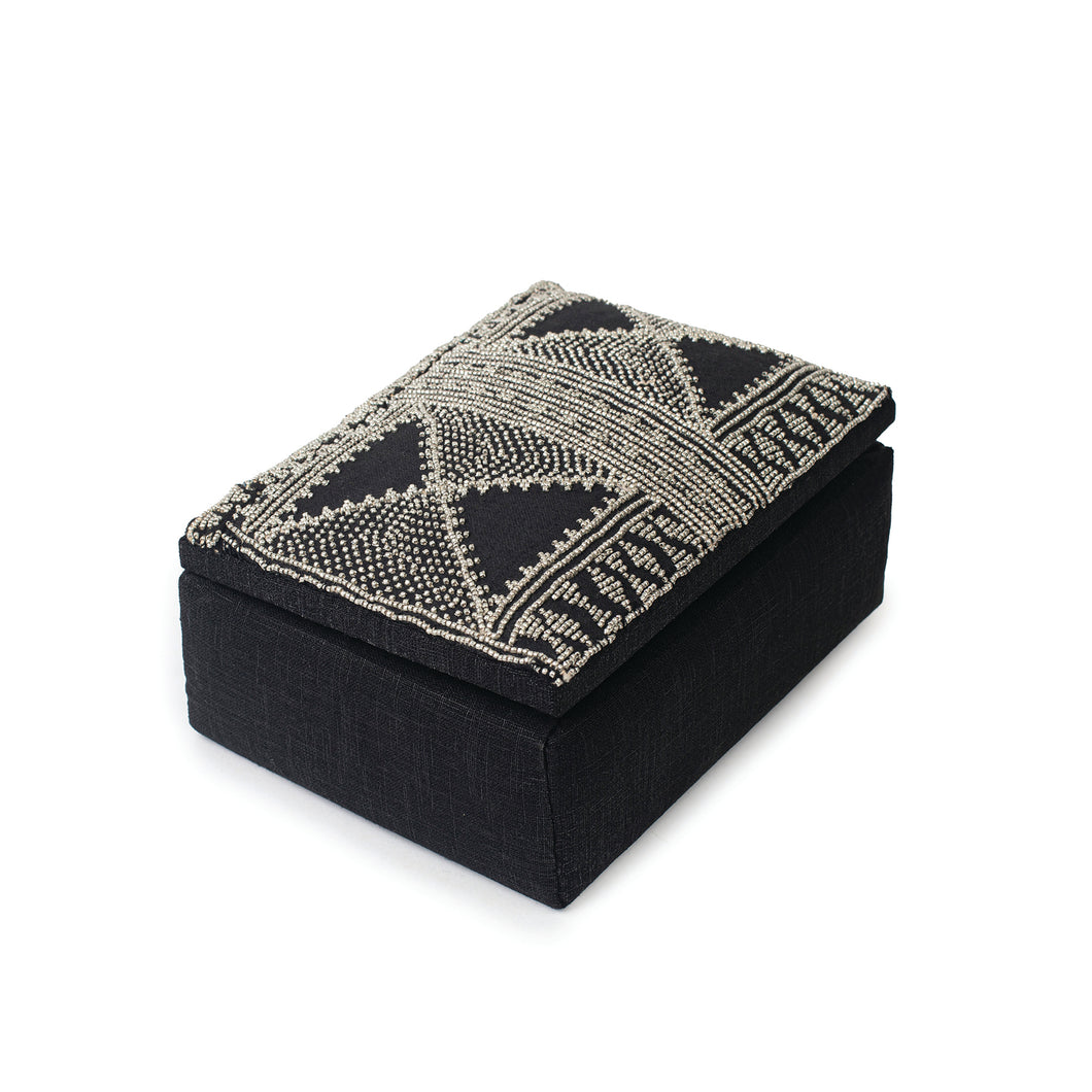 Side view of a box traditionally embroidered with lead beads