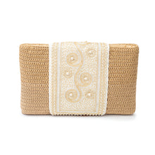 Back view of a white crochet clutch with a traditional Najdi design embroidered in gold thread and pearls on the flap