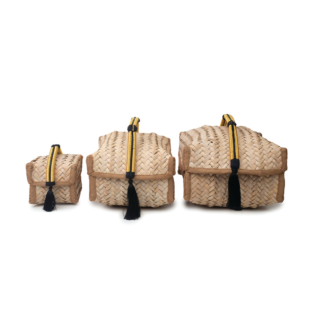 Group of hand-woven palm frond boxes in three sizes, all adorned with traditional Saudi Iqal (men's traditional headwear)