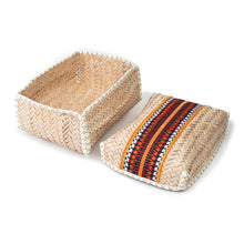 Top and inside view of a hand-woven palm frond box, adorned with traditional Sadu pieces
