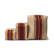 Group of hand-woven palm frond boxes in three sizes, all adorned with original Sadu pieces