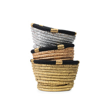 Group of hand-woven resin wicker baskets dyed silver, gold, or copper, and decorated with a traditional Saudi Iqal