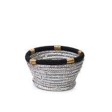 Front view of a hand-woven resin wicker basket dyed silver and decorated with a traditional Saudi Iqal