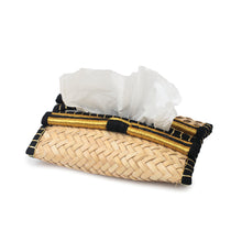 Side view of a hand-woven palm frond tissue box, decorated with a traditional Saudi Iqal (traditional men's headwear)