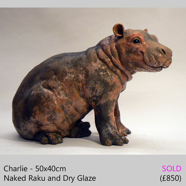 baby hippo sculpture