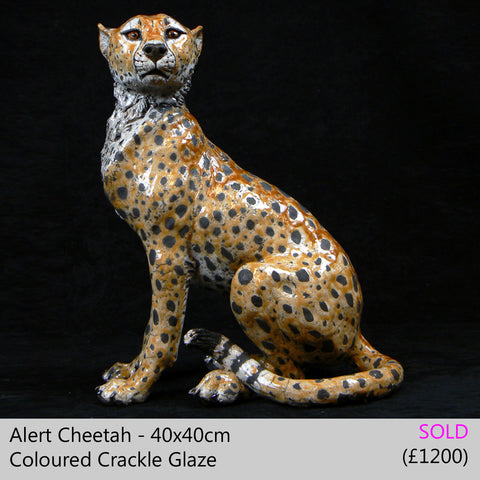cheetah sculpture big cat sculpture, raku fired ceramic sculpture by Lesley D McKenzie