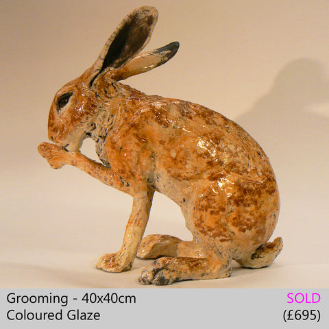 Grooming - raku fired ceramic hare sculpture by Lesley D McKenzie, art and animal sculpture