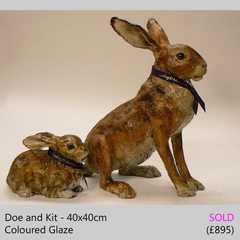 Doe and Kit - raku fired ceramic hare sculpture by Lesley D McKenzie, art and animal sculpture