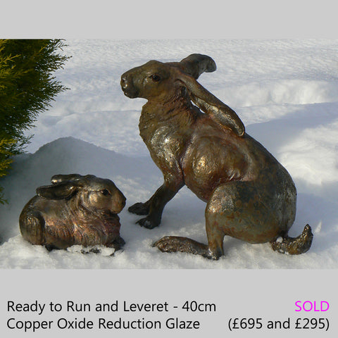 hare and leveret - raku fired ceramic hare sculpture by Lesley D McKenzie, art and animal sculpture