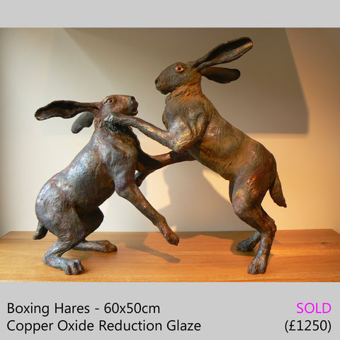 boxing hares, boxing hare sculpture - raku fired ceramic hare sculpture by Lesley D McKenzie, art and animal sculpture