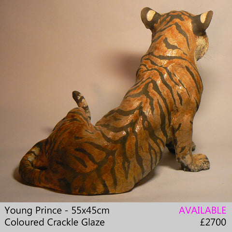 tiger sculpture big cat sculpture, raku fired ceramic sculpture by Lesley D McKenzie