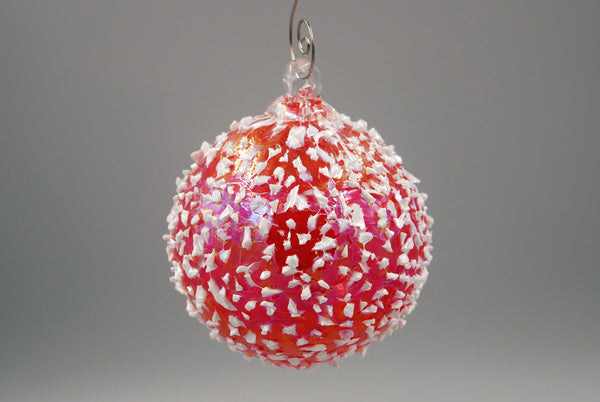 One cherry red blizzard ornament hanging from an ornament hook