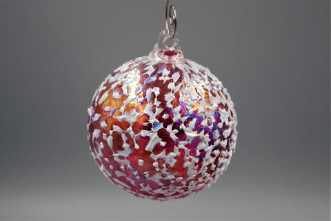 One cranberry blizzard ornament hanging from an ornament hook.