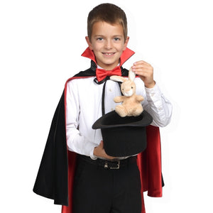 child wearing magician cape pulling rabbit out of hat