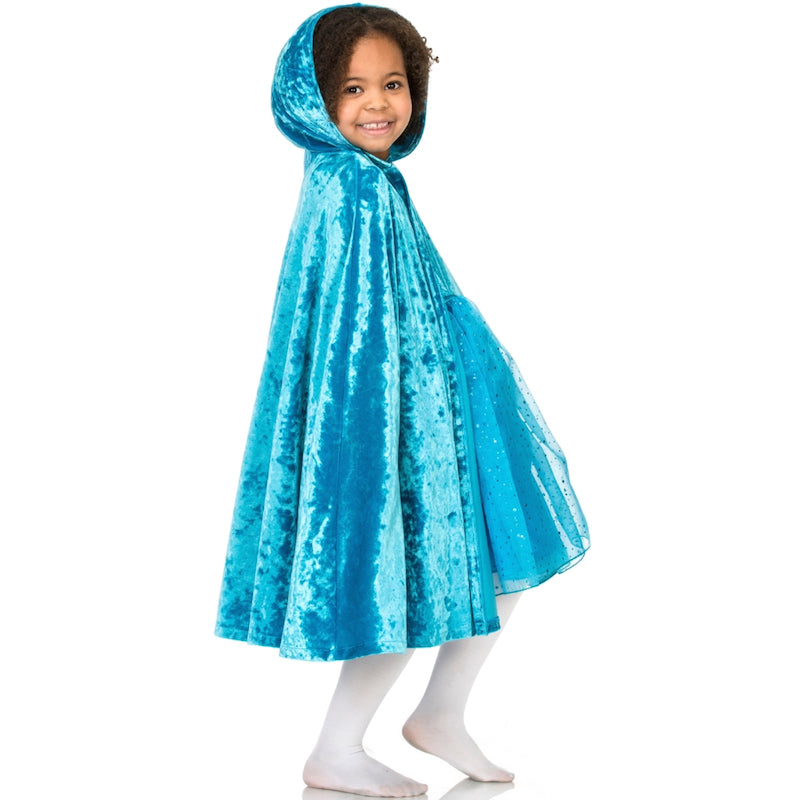 Child wearing turquoise velvet hooded cape