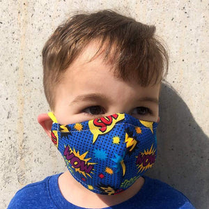 child wearing protective face mask in superhero print