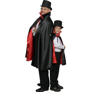 adult and boy wearing magician capes and top hats