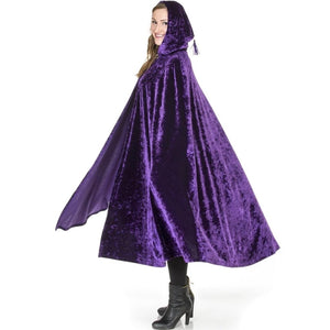 adult woman wearing purple velvet renaissance cape