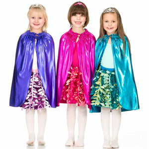 three girls wearing shiny costume capes and party petal skirts