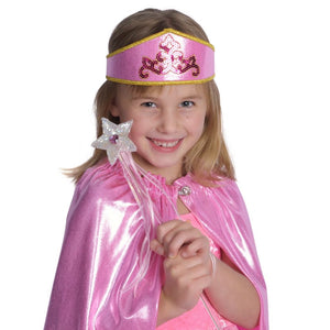 girl wearing pink princess crown and cape with wand