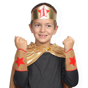 child wearing gold and red superhero crown and arm bands