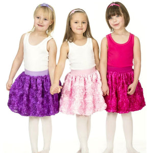 three girls dressed up in ribbon rose bubble skirts