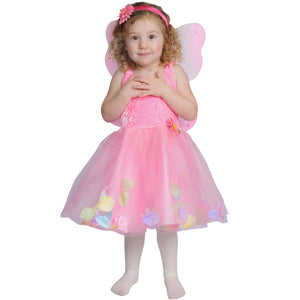 child dressed up in pink fairy dress and wings