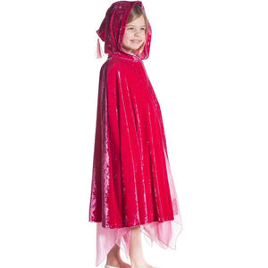 girl wearing fuchsia velvet hooded cape with tassel hood